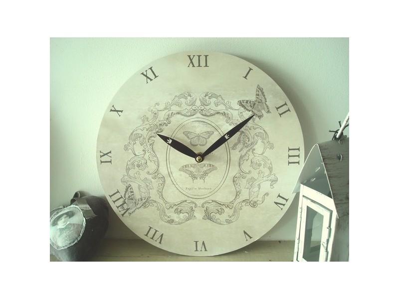 Horloge ronde arabesques rétro et papillon