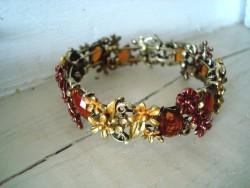 Fin bracelet fantaisie aux médaillons mordorés