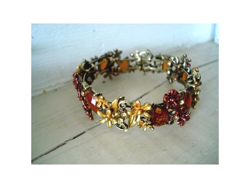 Fin bracelet vintage aux médaillons mordorés
