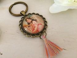 Porte clés fait main à la fillette à la harpe
