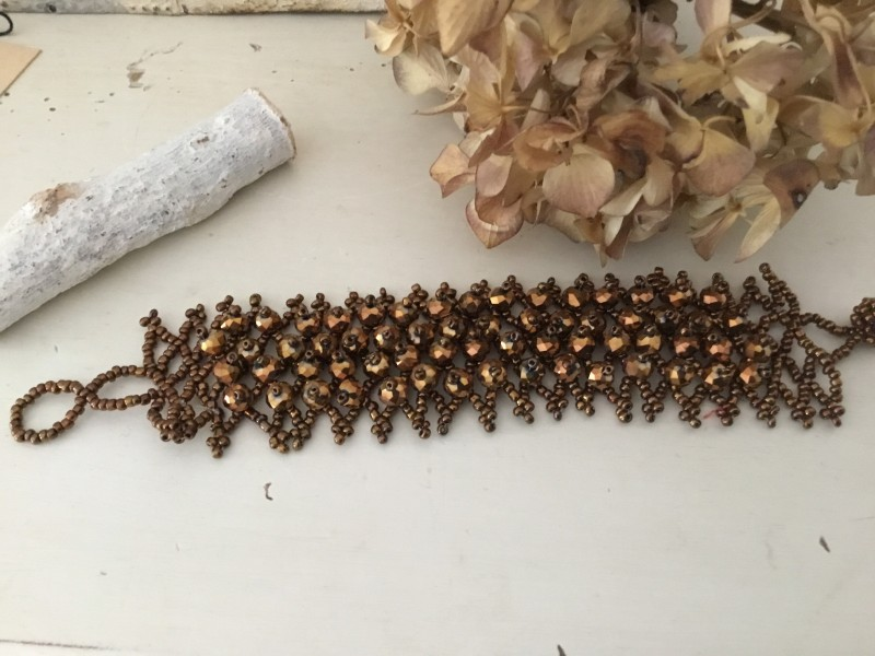 Bracelet fantaisie perles coloris vieil or tressées