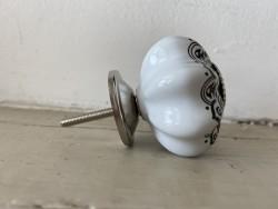 Bouton de porcelaine arabesque aspect rétro
