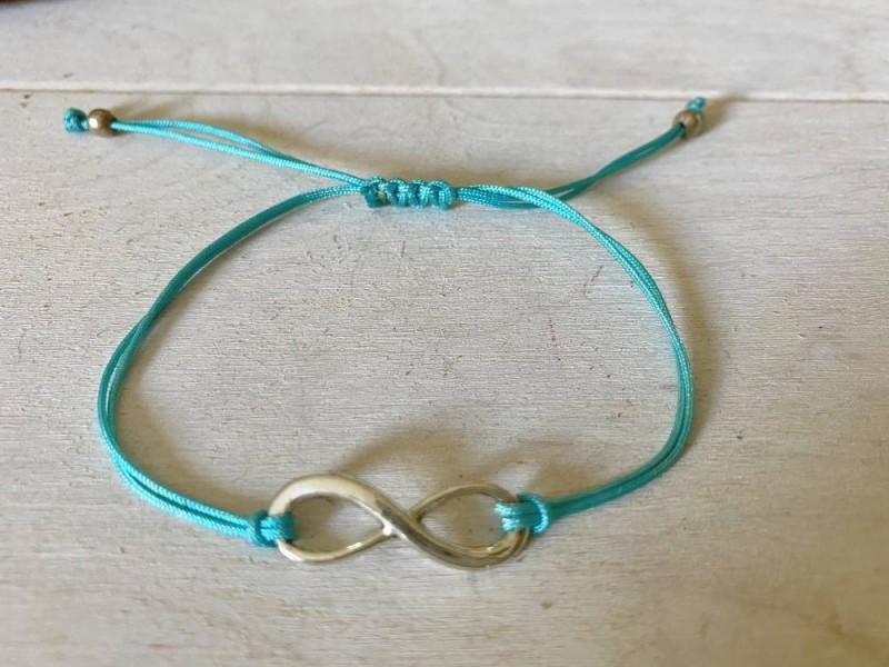 Bracelet sigle infini et cordon bleu turquoise