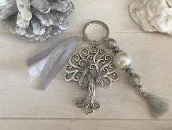 Porte clés original à l'arbre de vie et pompons gris