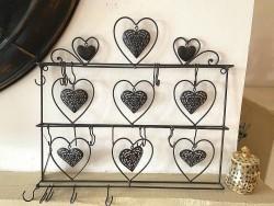 Porte bijoux en métal noir orné de coeurs